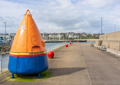 Eisenhower Pier, Bangor with RNLI buoy used for collecting money