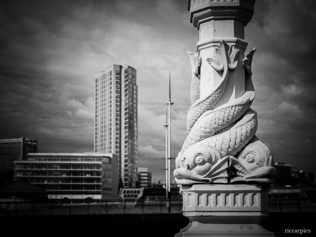 Ornate light on the Queen's Bridge, Belfast, Northern Ireland. The Obel Tower is visible in the background